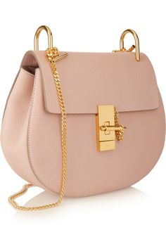 Chloé's 'Drew' shoulder bag comes in a new smaller size this season - perfect for off-duty days. It's crafted from blush textured-leather elegantly enhanced by polished gold hardware. The plush beige suede interior is ideally proportioned to hold your cell phone, keys and makeup essentials.