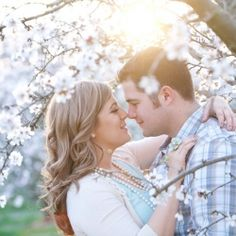This e-session can only be described as a romantic cherry blossom breeze mixed with mint tones + a whole lot of love. It's Spring perfection