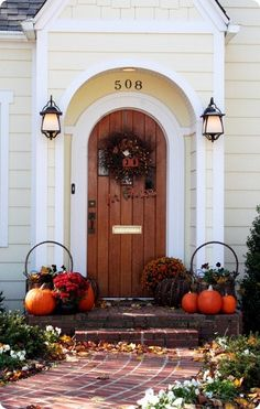love this, almost exactly my front porch, except brick, painted, perfect lamps, beautiful brick walkway........... but really, exactly!!  the door is EXACTLY, all the way down to the ribs and mailbox!!!  miss it tons!!