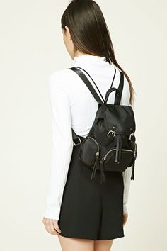 A structured mini backpack featuring a drawstring closure d1345ec1b720a