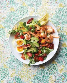 As pretty as it is scrumptious, our upgrade to the classic Cobb switches the usual chicken forshrimp but keepsthe other signature ingredients. The zesty cilantro-lime dressing is a fabulous new twist.  Check Out Our Other Favorite Shrimp Salad Recipes