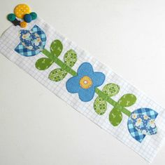 Bee Happy Blue Flowers block.  I love the tulip shaped flowers but not so much the middle one.