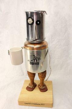 """""""Joe"""" ~ After that first cup of morning coffee. :) Original found object/junk art created by Laurie Schnurer in 2015. The canister opens by removing it's lid (along with Joe's head) and is usable."""