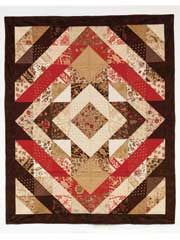 Cut the Cake - a quilt pattern by Baton Rouge quilt designer Connie Ewbank, that uses layer cakes.  Only $8.00. Pattern and Connie's sample available at Bright Hopes Quilting - 985-845-9554