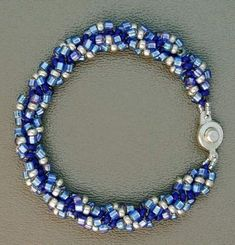 Spiral Bracelet a beadwork project for beginners by Marilyn Gardiner: www.MarilynGardiner.com Overview This is a beadwork project for beginners. The spiral rope is an extremely versatile stitch that every beader should know. It can be done with almost any size or combination of sizes of beads, and it can be embellished to your heart's content. …