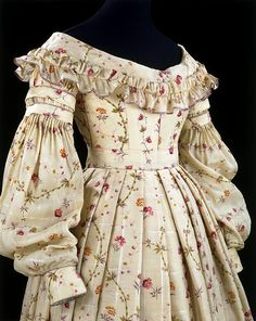 1837 dress. printed challis lined with glazed cotton and linen.