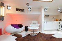 The B28 Houseboat is a chic one bedroom Amsterdam houseboat apartment that sleeps two guests located on the Central Canal Belt.