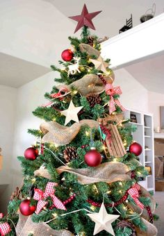 Rustic Christmas tree -- hessian and hints of red baubles, just enough for that rustic charm