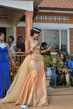 Perfect for a dressy wedding, this mother of the bride dress has a sequined lace bodice and a dramatic mikado skirt punctuated by a ladylike sash. African Bridesmaid Dresses, African Wedding Attire, African Maxi Dresses, Latest African Fashion Dresses, African Dresses For Women, African Print Fashion, African Attire, Lace Gown Styles, Lace Dresses