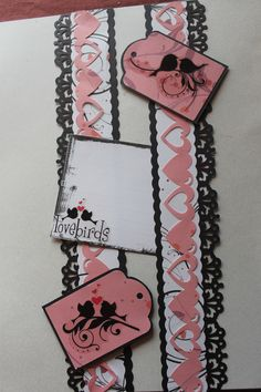 Be Mine additions from CM.  Heart strip punched with the double heart chain from CM, and the black cardstock punched with the butterfly punch from OMFL