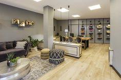 Interior design for Varanasi travel agency office. By 08130 estudi de disseny (Barcelona). #interiordesign #officedesign #travelagency #furniture #sofa #table #books #hats