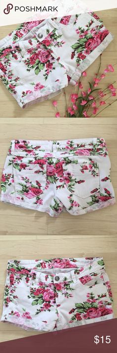 white and pink floral denim shorts Cute shorts in great condition! They are tagged as a 7/8 juniors; please see measurements in photos to help determine fit! Bundle to save; price negotiable  Rue 21 Shorts Jean Shorts