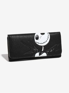 "This wallet is the furthest thing from a nightmare - it's an absolute dream come true!   The tri-fold wallet features a debossed Jack Skellington design. The interior lining has an allover  The Nightmare Before Christmas  print.  3 internal slots, 1 exterior zipper pouch; 3 interior cash slots, 7 credit card slots; Magnetic snap closure.  A BoxLunch Exclusive!     8"" x 4"" x 1""  Man-made materials  Imported"