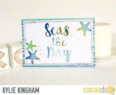 Card ~ Seas The Day, by Kylie Kingham using the Under the Sea collection from www.cocoadaisy.com #cocoadaisy #kitclub #scrapbooking #cards #cutfiles #faux #stitching #watercolor #doodle #ink #splatter