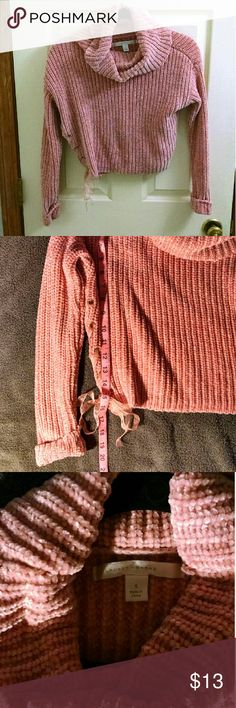 """Dusty Pink Crop Sweater Dusty pink crop sweater by Lauren Conrad with lace up ribbon detail and cuffed sleeves. I really like this sweater, but it's an awkward length on me personally (I'm 5'6"""" with a longer torso). Size small, would work on an extra small well too I think. 100% polyester. Sweater length approximately 16 in, sleeve length approximately 20 inches. Worn once. Lauren Conrad Sweaters Cowl & Turtlenecks"""