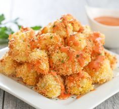 These Parmesan cauliflower bites are crunchy and addicting. They make a yummy snack and are ready in less than 30 minutes. I've become obsessed with roasted cauliflower lately. These cauliflower bites are breaded, baked until crispy Baked Cauliflower Bites, Bang Bang Cauliflower, Cauliflower Recipes, Parmesan Cauliflower, Cauliflower Breadsticks, Cheesy Cauliflower, Cheesy Breadsticks, Cauliflower Salad, Vegetable Dishes
