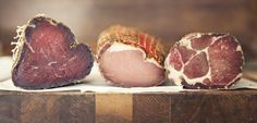 Charcuterie muscle meats in a row. BRESAOLA | COPPA & LOMO