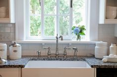 An additional window adds more natural light to this beautiful kitchen remodel. Window Over Sink, Kitchen Sink Window, Kitchen And Bath Design, Sink Faucets, Beautiful Kitchens, Polished Chrome, Kitchen Remodel, New Homes, Windows