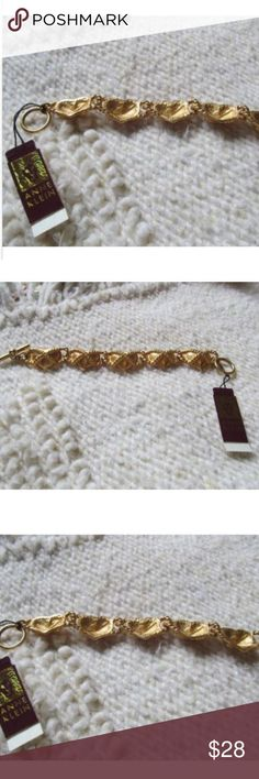 """Vintage Ann Klein CROSS MY HEART HOPE Bracelet NWT VALENTINE BRACELET !!!!!!!    Vintage Ann Klein ( New with original Tag)  ( Cross  my Heart Hope to Die) Heart Bracelet measuring app.  5 1/2"""" x 3/4"""".   It has a toggle fastener. This is in near Mint Condition- I would say never worn as it still has the original tag on it.  Beautiful Gift.   Thank you for looking and good luck. Anne Klein Jewelry Bracelets"""