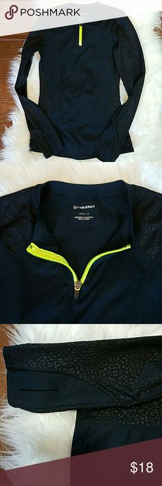FABLETICS 1/4 Zip LS Pullover FABLETICS 1/4 Zip LS Pullover with thumbholes. Excellent condition! Black with a black type animal print on arms and sides.   Size XXS (2) Fabletics Tops