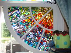 Thousands of tiny pieces of glass in an old window frame with sunny to cool colors and a Van Gogh feel