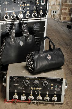 Handbags, product still life photography, with vintage STROBE props. Biker Chick Chic with Gothic overtones fashion accessories, marketing and adverting photography Sydney.