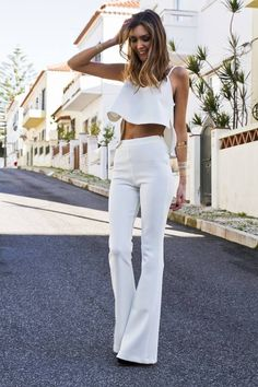 The best thing about flared pants is how long and lean they make your legs look. Trouser Outfits, Jean Outfits, Casual Outfits, White Flare Pants, Flare Jeans, English Fashion, Independent Women, Wide Leg Jeans, Bell Bottoms