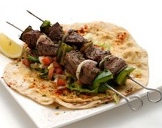 Beef or chicken kebabs served over warm lafa bread and red pepper. Kebabs, Red Peppers, Cape Town, Beef, Stuffed Peppers, Warm, Spaces, Chicken, Street