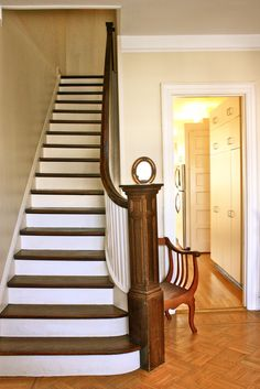 Like the mix of stain and paint on the stairs. Helps keep it from being a dark blot in an entry that is hard to balance or if white a space that is not grounded. Also, note the railings are simply square, not ornate. Like that