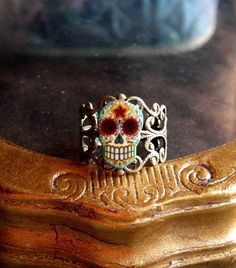 Antiqued Day of the Dead Filigree Sugar Skull Ring Brass Finish. $9.95, via Etsy.