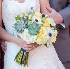 White, soft yellow, navy & even touches of black in this wedding bridal bouquet. Succulents, hydrangea, anemones, & garden roses. Soft, modern, romantic & stunning.