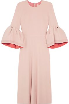 This 'Turlin' dress demonstrates how beautifully Roksanda combines modernity and romance, structure and fluidity. Made in England from pastel-pink stretch-crepe, it has a softly flared skirt contrasted with sculptural bell cuffs that are top-stitched in a deeper pink and apricot on the reverse.