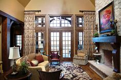 Classic livingroom: Windsor Pinnacle Series clad wood windows and swinging patio doors, all with alder wood interiors. www.windsorwindows.com.