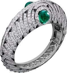 Bracelet - white gold, 9.46-carat and 10.04-carat cabochon-cut emeralds from Brazil, onyx, calibré-cut diamonds, brilliant-cut diamonds.