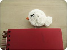 Crochet bird paperclip. I like the stitch for the eye on this one. So demure and sweet!