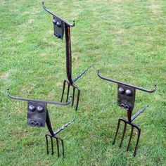 Rusted steel and recycled garden forks Garden sculpture by artist Katie Lake titled: 'Lawn Cows (Amusing Recycled Semi Abstract Statues)' £140