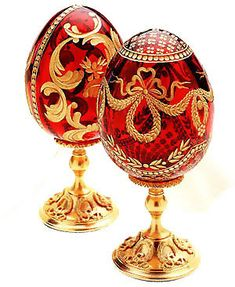 "(2) FABEGRE eggs__""Alexandra and Ribbon "" Crystal Egg During the reign of Alexander III, Fabergé created 1 Easter egg each year. After the death of his dad whenever Nicolas II ascended to the Russian throne inside 1894, Fabergé produced 2 eggs - 1 for the active Czar's mom Maria Feodorovna plus another for the Czarina Alexandra Feodorovna. Mouth blown and copper wheel engraved crystal egg with 24k hand-painted gold decoration. Mounted on gold-plated bronze Laurel stand."