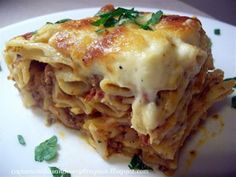 Greek Pastichio - Layers of meat sauce, cheesy pasta, and bechamel