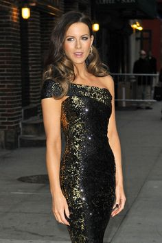 """Kate Beckinsale Photos - Kate Beckinsale, star of the new film """"Underworld: Awakening"""", poses up for photographers before an appearance on """"The Late Show with David Letterman"""". The slim beauty wore a sparkly, off the shoulder dress and high heels for her appearance on the late night talk show. - Kate Beckinsale Arrives for 'Letterman' 2"""