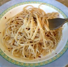 You will need:  Pasta (Linguine and Spaghetti are my favorites for this recipe)  Red pepper flakes  Olive oil  Fresh minced garlic  Grated Parmesan cheese   1. Cook your pasta according to the directions (above photo is whole wheat linguine)  2. Drain pasta and pour into bowl  3. Add minced garlic, red pepper flakes, olive oil, and Parmesan cheese to taste.