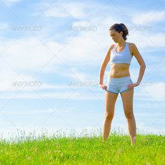 Mature Woman Athlete (adult, alone, athlete, athletic, attractive, beautiful, beauty, blue, bright, caucasian, copyspace, exercise, female, fit, fitness, girl, grass, green, health, healthy, human, jogger, landscape, lifestyle, nature, outdoor, outside, park, person, practice, pretty, recreation, runner, sky, slim, sport, sporty, spring, summer, train, training, vitality, wellbeing, wellness, white, woman, workout, young)
