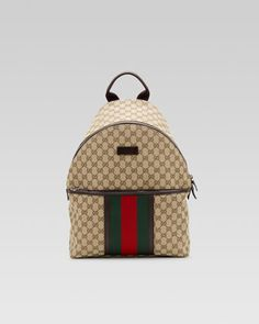 Original GG Canvas Backpack by Gucci at Neiman Marcus. Luggage Backpack 966a9866ef50c
