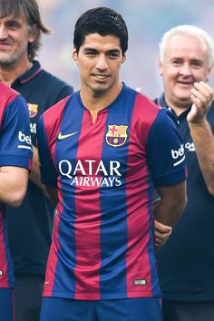 Luis Suarez of FC Barcelona looks on during the official presentation of the FC Barcelona prior to the Joan Gamper Trophy match between FC Barcelona and Club Leon at Camp Nou on August 18, 2014 in Barcelona, Catalonia.