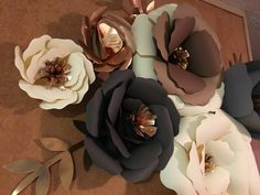 A personal favorite from my Etsy shop https://www.etsy.com/listing/513176359/neutral-giant-paper-flowers-metallic