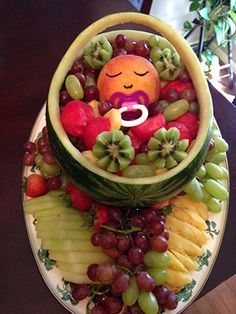 Watermelon baby carrier fruit salad for baby shower by Rosie Grutas. See fancier watermelon baby carriages at http://www.vegetablefruitcarving.com/blog/watermelon-baby-carriage/