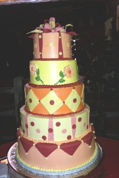 wedding cake with lots of color wwwcheesecakeetcbiz wedding cakes charlotte nc