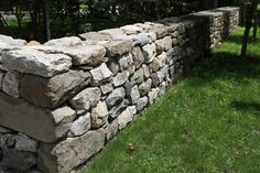 When I bought my property, I hired a crew to enclose it behind this very long stone wall.  It's very well-made from field stones and I love its rustic look.  Alfredo of Bedford built the perimeter walls around the property and they are sturdy and strong just like his crew.