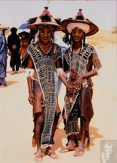 The Wodaabe men, dressed and painted for the yearly tribal dans. Here the girls often choose their husband so the face paint has to be perfect.The eye rolling is also important, I think its considered sexy.....