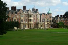 Sandringham House, Norfolk.  Originally purchased as a home for the future King Edward VII, Sandringham House remains one of the privately owned homes of The Sovereign. The Queen spends  Christmas here with the family, and remains in residence until February, after the anniversary of her accession to the throne.  Within the grounds are several other residences.