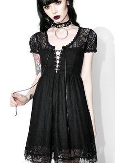 Killstar Bella Morte Lost Babydoll Dress will have ya lookin' like an ethereal goddess by candlelight, somebody get the Ouija Board! This supa luxe short sleeve dress features lavish Victorian-style lace panels, fully lined construction with scoop neckline, cutout back, and corset lace-up front closures.